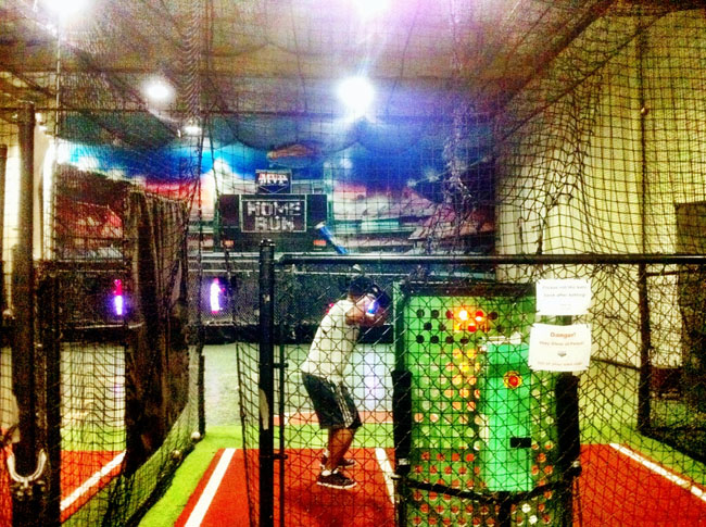 ed and lyss at the batting cage